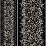 Seamless black and white vertical lace pattern with paisley. Vector set of 2. Royalty Free Stock Photography
