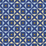 Seamless blue abstract pattern with yellow and blue shamrocks. Stock Image