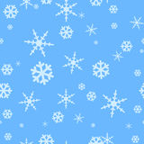 Seamless blue background with falling snowflakes Royalty Free Stock Photo