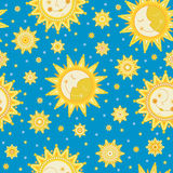 Seamless blue background with the image of the sun, moon, stars. Stock Photos