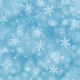 Seamless blue background with snowflakes royalty free stock photos