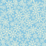 Seamless blue background with snowflakes. Pattern snowfall. Stock Photos