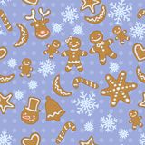Seamless blue Christmas pattern with cute gingerbread men and other cookies Royalty Free Stock Photography