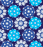Seamless blue floral pattern. On a blue background Royalty Free Stock Photos