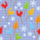 Seamless blue New Year pattern with Russian traditional rooster sugar lollipop Stock Photos