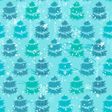 Seamless blue pattern with fir trees Royalty Free Stock Photo