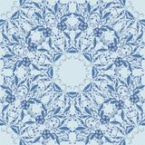 Seamless blue pattern with flowers and leaves made up of circular patterns. Royalty Free Stock Image