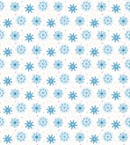 Seamless blue pattern of many snowflakes on white background. Ch. Ristmas winter theme for gift wrapping. New Year seamless background for website Royalty Free Stock Image
