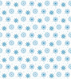 Seamless blue pattern of many snowflakes on white background. Ch. Ristmas winter theme for gift wrapping. New Year seamless background for website Royalty Free Stock Images