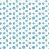Seamless blue pattern of many snowflakes on white background. Ch Royalty Free Stock Photography