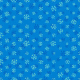 Seamless blue pattern with snowflakes Stock Photography