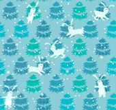 Seamless blue pattern with trees and rabbits Royalty Free Stock Image