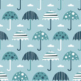 Seamless blue umbrellas Stock Photography