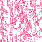 Seamless boho pattern of a feathers and keys. Royalty Free Stock Image