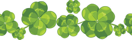 Seamless border with clover leaves stock image