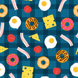 Seamless breakfast pattern with cheese, bacon, eggs, tomatoes and donuts. Vector illustration. Seamless breakfast pattern with cheese, bacon, eggs, tomatoes and Royalty Free Stock Images