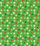 Seamless Bright Abstract Pattern with Stars in Christmas Colors. On Green Background Stock Photos