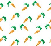 Seamless bright background. Orange carrots on a white background Royalty Free Stock Images