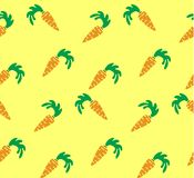 Seamless bright background. Orange carrots on yellow backdrop Royalty Free Stock Photography