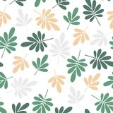 seamless bright graphically stylized green and yellow natural leaves pattern texture element on white background Stock Photography