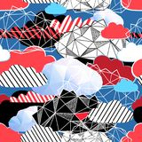 Seamless bright pattern from different clouds. On a blue background Stock Photo