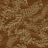 Seamless brown background with spirals, plants and swirls Royalty Free Stock Photography