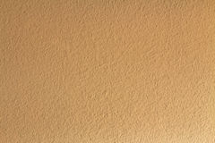 Seamless brown painted concrete wall. Royalty Free Stock Image