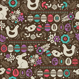 Seamless brown pattern with color easter eggs, rabbit, flowers Royalty Free Stock Photos
