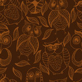 Seamless brown pattern of four different owls Stock Photography