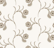 Seamless brown pattern with openwork swirls and flowers Stock Photography