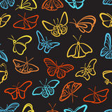 Seamless butterfly pattern. Seamless pattern of butterflies on a black background Royalty Free Stock Photo