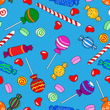 Seamless candy pattern over blue Stock Images