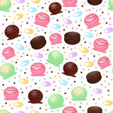 Seamless Candy Pattern. A seamless pattern of candy truffles and chocolates Royalty Free Stock Photos