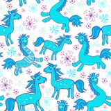 Seamless with cartoon blue horses. The bright winter seamless pattern Royalty Free Stock Images