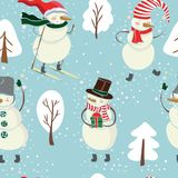 Seamless cartoon color pattern with winter trees, snowman in hat, ski on blue background. Royalty Free Stock Image