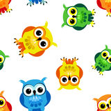 Seamless cartoon owls. Seamless pattern of cute and fun cartoon owls in colorful yellow, blue, green and orange, perfect kid design Stock Image