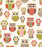 Seamless cartoon owls pattern Stock Images