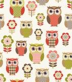 Seamless cartoon owls pattern Stock Images