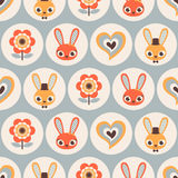 Seamless cartoon rabbits pattern. Seamless cute cartoon rabbits pattern Royalty Free Stock Images