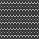 Seamless chain link fence background. Seamless metal chain link fence on black background. Wired Fence pattern in shades of grey. Stylish repeating texture Royalty Free Stock Photography
