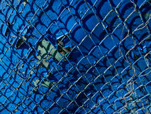 Seamless Chain Link Fence. On blue color Royalty Free Stock Images