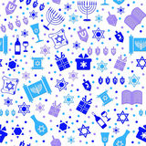Seamless Chanukah Pattern. A pattern of dreidels wine presents torahs books menorahs and stars of David for Chanukah stock illustration