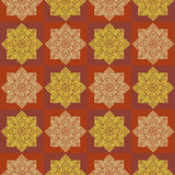Seamless checkered pattern with ethnic rosettes on a dark background Stock Photography