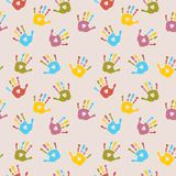 Seamless cheerful pattern with multi-colored palm prints. Seamless cheerful pattern with a multi-colored palm prints Royalty Free Stock Photos