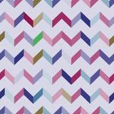 Seamless chevron  pattern. Colorful zig zag in pink, violet, green, brown and blue colors on light purple background. Stock Photo