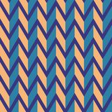 Seamless chevron vector pattern. Colorful orange zig zag on purple background. Stock Images