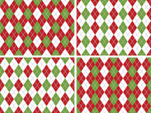 Seamless Christmas Argyle Patterns in Green and Red. Four Seamless Christmas Argyle Patterns in Green, Red and White with Solid Silver line. Vector file contains Royalty Free Stock Images