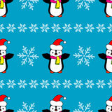Seamless Christmas  background with ornamental snowflakes and penguins Royalty Free Stock Photos