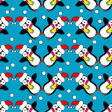 Seamless Christmas  background with ornamental snowflakes and penguins Stock Images