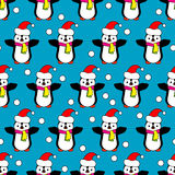 Seamless Christmas  background with ornamental snowflakes and penguins. Seamless Christmas background with ornamental snowflakes and penguins Stock Photos